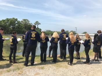 FFA students at pond for CDE